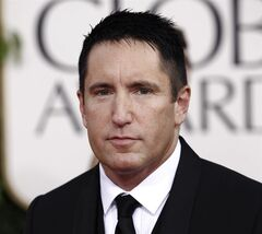 FILE - In this Jan. 16, 2011 file photo, Trent Reznor arrives for the Golden Globe Awards in Beverly Hills, Calif. Reznor and officials at Beats By Dre agree: Reznor is still with the company. Reznor tweeted Monday, June 2, 2014, that he remains the company's chief creative officer. (AP Photo/Matt Sayles, file)