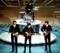 FILE - In this Feb. 9, 1964, file photo, The Beatles, from left, Paul McCartney, George Harrison, Ringo Starr on drums, and John Lennon perform on the CBS