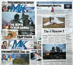 CORRECTS DATE TO JULY 20, FILE - This July 20, 2014 file photo, shows a combination of images of Russian nationwide weekend dailies' front pages on downed Malaysia Airlines Flight 17 in Moscow Russia, some of them reading
