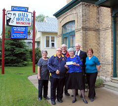 The Wheat City Lions present a cheque for $2,000 to the Victorian Garden Committee of Daly House Museum. Pictured (L-R) are committee member Barb Andrew, incoming Lions president Peter George, committee member Robert Booth, committee chair Sylvia Barr, outgoing Lions president Murray Tallant, and Daly House curator Eileen Trott.