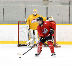 Calen Addison skates with the puck at a Brandon Midget AAA Wheat Kings practice last week.