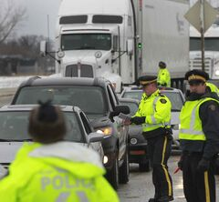 RCMP officers on the Trans Canada Highway as part of the Holiday Checkstop Program.