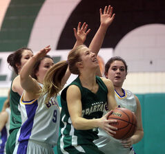 Neelin Spartans' Kristine Ward drives the ball to the Virden Golden Bears' basket during the Java Jam high school basketball tournament Thursday at Neelin.