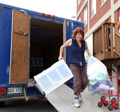 Heather Sharpe is all smiles as she moves her belongings into Massey Manor on Thursday.