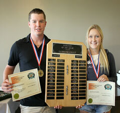 Elton's Ryan Muirhead and Courtney Fines hold their athlete of the year awards.