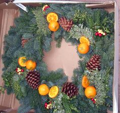 Fresh fruit can be added to a wreath. Photo taken at Patmore's Nursery.