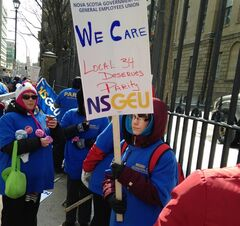 Striking home care workers marching outside Nova Scotia legislature in Halifax on Friday February 28, 2014. THE CANADIAN PRESS/Michael Tutton