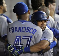 Toronto Blue Jays' Melky Cabrera right, celebrates with teammate Juan Francisco (47), in the dugout after Cabrera hit a two-run home run during the second inning of a baseball game against the Chicago White Sox in Chicago, Friday, Aug. 15, 2014. (AP Photo/Paul Beaty)