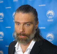 Anson Mount, the star of Hell on Wheels speaks to reporters on the red carpet at the Banff World Media Festival on Tuesday, June 10, 2014. Mount says he's not using a 'method' when he assumes the role of a tortured Confederate soldier bent on seeking revenge against those who killed his wife and young son. THE CANADIAN PRESS/Bill Graveland