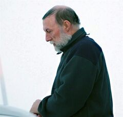 Catholic priest Eric Dejaeger leaves an Iqaluit, Nunavut courtroom Jan. 20, 2011 after his first appearance for six child sexual abuse charges in Igloolik dating back to the 1970s. THE CANADIAN PRESS/Chris Windeyer