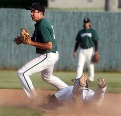 Travis Jean of the Brandon Cloverleafs slides but is forced out at second by Neepawa's Bryce Stephenson.