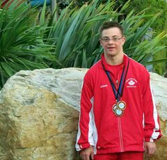 More than 200 swimmers from 21 nations participatedin the sixth International and World Competition convened by the Down Syndrome International Swim Organization held in Italy. For Jason Norminton, who swims with both the Brandon Special Olympics team and the Brandon Bluefins Swim Club, it was a very successful meet as he brought home several gold, silver and bronze medals.