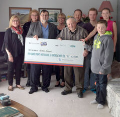 Arthur Fingas, a longtime western Manitoba farmer who now lives in Russell, celebrates with his family after winning $521,625, the largest 50/50 prize in Manitoba Hospital Lottery history, as part of the St-Boniface Hospital Foundation's 2014 Mega Million Choices Lottery.