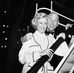FILE - This Oct. 3, 1961 file photo shows Noel Coward, right, with actress Elaine Stritch backstage at New York's Broadhurst Theatre after the Broadway opening of