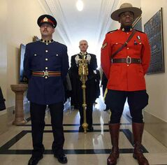 Sergeant-at-arms Blake Dunn carries the mace into the Manitoba legislative chamber for the Nov. 19 throne speech.