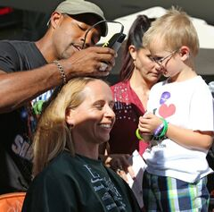 Karen Whitfield gets her head shaved by celebrity barber Jason Winston George, one of the stars of