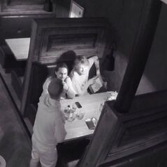This photo provided by Tyler Christensen, shows a surveillance photo of a man placing a painting in his backpack at the McMillan Bar and Kitchen in Flagstaff, Ariz. Two accomplices in the theft of the painting at the restaurant have come forward after a shaming campaign on Facebook. Tyler Christensen, the owner of McMillan Bar and Kitchen, went to social media instead of police after the painting went missing on June 9, 2014. Christensen posted an open letter and surveillance photo. He says the two accomplices have since come forward and given $500 to cover the cost of the artwork. Christensen's Facebook post has been shared more than 7,900 times and received more than 4,300 likes and nearly 770 comments. (AP Photo/Courtesy of Tyler Christensen)