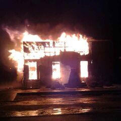 The building housing Rapid City's town office and fire hall is shown ablaze overnight on Sunday. Emergency workers were alerted to the fire around midnight.