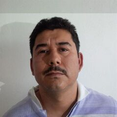 FILE - In this file image released by the Mexico Attorney General's Office on Saturday, Feb. 22, 2014, Carlos Manuel Hoo Ramirez is photographed against a wall right after he was arrested along with Joaquin