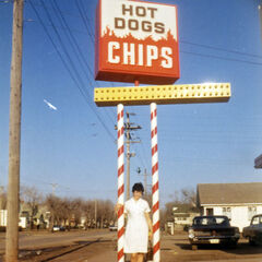 One of the original co-owners of Velvet Dip, Donna Ferguson (Hansen), poses for a photo outside the ice cream shop in April 1969 when it started selling food.