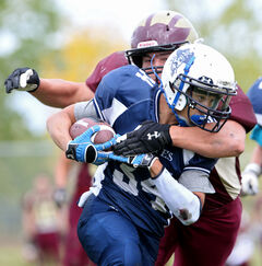 Crocus Plainsmen linebacker Steven Siebrecht tackles ball carrier Khelyn Kull of the Grant Park Pirates on Sept. 20.