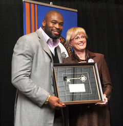 Israel Idonije accepts a key to the City of Brandon from Mayor Shari Decter Hirst in March 2011.