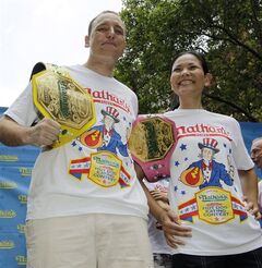 FILE - In this July 3, 2012, file photo, hot-dog eating champions Joey Chestnut, left, and Sonya