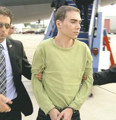 Luka Rocco Magnotta is taken from a military plane to a waiting vehicle on June 18.