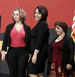 FILE - This Monday Feb. 24, 2014 file photo shows from left, Amanda Berry, Gina DeJesus and Michelle Knight introduced at the Performing Arts Center in Medina, Ohio. The three women held captive in a Cleveland house before escaping a year ago Tuesday have spent their first year of freedom learning to drive, taking boxing lessons and cherishing time with their families. Berry and DeJesus both said in statements released Monday, May 5, 2014 that they are thankful and growing in many ways. (AP Photo/Tony Dejak, File)