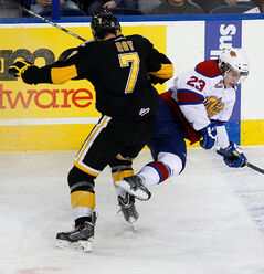 Brandon defenceman Eric Roy collides with Edmonton's Edgars Kulda in Thursday's opener.