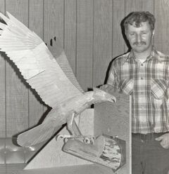 Family photograph of James Allen Masters, with a carved owl.