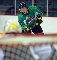 Rookie Jayce Hawryluk takes a shot on goal in Brandon Wheat Kings practice Tuesday at the Kinsmen Arena.