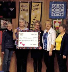 Nifty Needlers (L-R) Mable Humphreys, Barb Walker, Joyce Hopper and Mrs. Boreskie present a cheque for $4,077.67  to (middle) Cindy Buizer, executive director of the BRHC Foundation. This amount represents the proceeds from their 2012 quilt raffle.