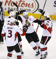 Ottawa Senators' Jason Spezza (19), center, is greeted by teammates after scoring the game-winning goal during the third period of an NHL hockey game, Tuesday, Jan. 28, 2014, in Columbus, Ohio. The Senators and Bell Media have reached a 12-year agreement that gives TSN and RDS regional broadcast rights to the team's games.THE CANADIAN PRESS/AP/Mike Munden
