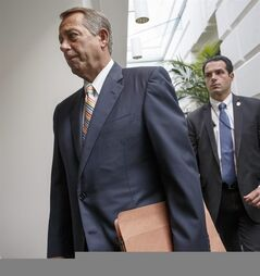 Speaker of the House John Boehner, R-Ohio, arrives for a meeting of the Republican Conference on Capitol Hill in Washington, Tuesday, July 29, 2014. (AP Photo/J. Scott Applewhite)