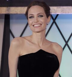 Angelina Jolie smiles as she poses for photographers during the Japan premiere of