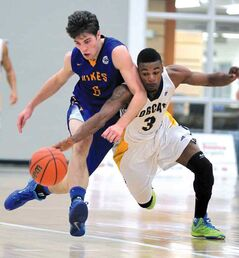 Brandon's Kenonte Ramsey (right) battles Victoria's Mack Roth for a loose ball back on Nov. 1. (File)