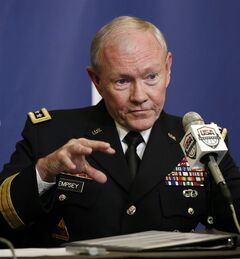 FILE - This Aug. 20, 2014 file photo shows Joint Chiefs Chairman Gen. Martin Dempsey speaking in New York. President Barack Obama's military leadership made clear in recent days that the threat from the Islamic State militants, who murdered American journalist James Foley, cannot be fully eliminated without going after the group in Syria, as well as Iraq.