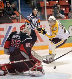Brandon Wheat King Chad Robinson fires a shot at Moose Jaw netminder Daniel Wapple on Friday.