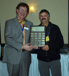 Toastmasters District 64 Governor Scott Winning (left) presents Gerald Allen, of Brandon's Sky-Hy club, with the George Craigie Memorial Award for his commitment at the local level.