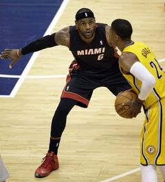 Miami Heat forward LeBron James (6) defends Indiana Pacers forward Paul George (24) during the first half of Game 2 of the NBA basketball Eastern Conference finals in Indianapolis, Tuesday, May 20, 2014. (AP Photo/AJ Mast)