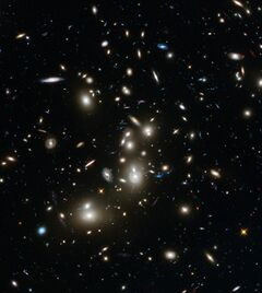 This undated image made available by the European Space Agency and NASA on Tuesday, Jan. 7, 2014 shows galaxies in the Abell 2744 cluster, and blue galaxies behind it, distorted and amplified by gravitational lensing. The long-exposure image taken with NASA's Hubble Space Telescope shows some of the intrinsically faintest and youngest galaxies ever detected in visible light. (AP Photo/ESA/NASA)