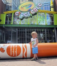 William Schmid, 18 months, of Gardners, Pa., plays outside the Crayola Experience attraction Tuesday, July 29, 2014, in Easton, Pa. Crayola announced Tuesday it will build a second attraction at The Florida Mall in Orlando, Fla., to open in summer 2015. (AP Photo/Michael Rubinkam)