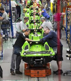 Employees work on the SeaDoo assembly line at the Bombardier Recreational Products plant Thursday, June 12, 2014 in Valcourt, Quebec.THE CANADIAN PRESS/Ryan Remiorz