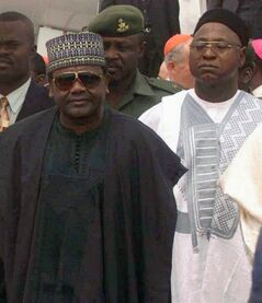 FILE - In this file photo taken on Saturday, March 21, 1998, late Nigeria President Gen. Sani Abacha, left, attends an event in Abuja, Nigeria. Liechtenstein is returning $227 million looted by Nigeria's late military dictator after the Nigerian government made a deal with his eldest son to drop corruption charges against the son, the government said Thursday, June 19, 2014. (AP Photo/Jerome Delay, File)