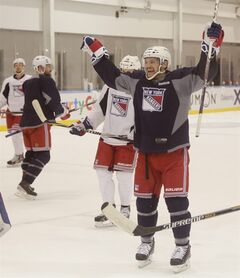 New York Rangers left wing Daniel Carcillo (13) reacts after a goal scored during practice, Monday, June 2, 2014, in Greenburgh, N.Y. The Rangers will face the Los Angeles Kings in Game 1 of Stanley Cup Final in Los Angeles on Wednesday. (AP Photo/Julie Jacobson)