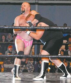 Vern May, seen here in pink trunks as wrestler Vance Nevada, is the new economic development officer for the Souris-Glenwood Community Development Corp.