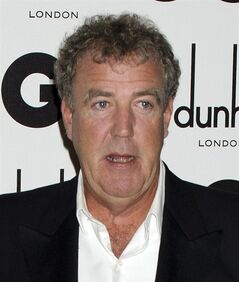 "FILE - In this Sept. 6, 2011 file photo, TV host Jeremy Clarkson arrives for the GQ Men of the Year Awards in London. ""Top Gear"" host Jeremy Clarkson has apologized and asked for forgiveness following allegations that he used racist language while he was shooting an episode of the popular BBC show. The BBC said Friday May 2, 2014 it is taking the allegations seriously. (AP Photo/Jonathan Short, File)"