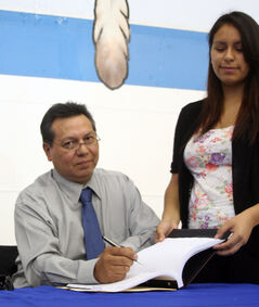 In this August 2013 photo, Sioux Valley Dakota Nation Chief Vince Tacan signs the first-ever self-government agreement in the Prairie provinces.