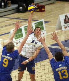 Bobcats' Roy Ching powers the ball over the net during Saturday's university volleyball game against the visiting UBC Thunderbirds at the BU Healthy Living Centre.